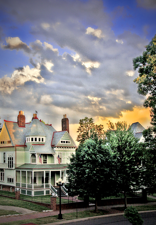 treatment of a photo of clouds over a Victorian house in Peoria, Illinois